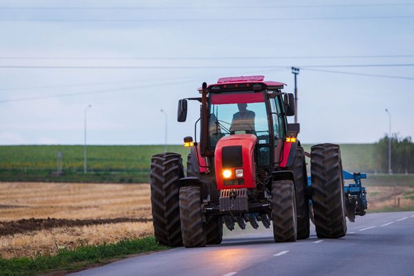 Red Tractor on road